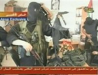 Hamas fighter with captured weapons