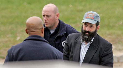 Sholom Rubashkin does the 'perp walk'