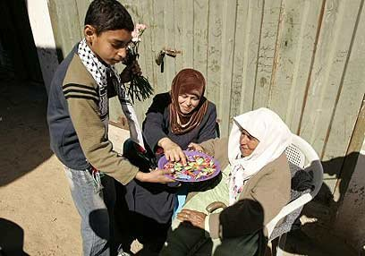 Palestinians distribute candy in Gaza