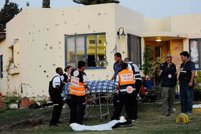 The body of Jimmy Kedoshim is removed from his home in Kfar Aza