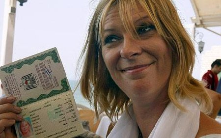 Lauren Booth with her Palestinian 'passport'