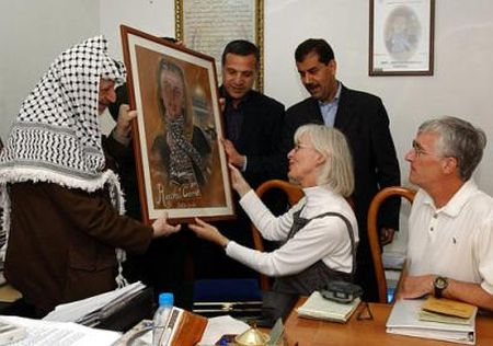 Cindy and Craig Corrie receive portrait of Rachel from the Original Terrorist