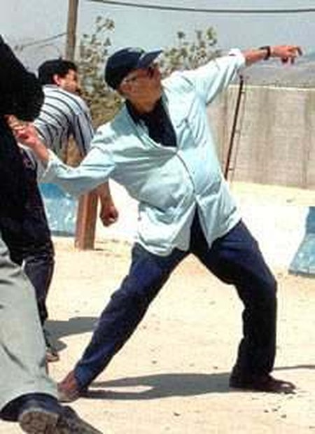 Postcolonial theorist Edward Said throws a stone at Israeli soldiers across Lebanese border in 2000. He missed.
