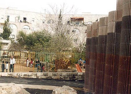 Playground in Gilo. Note concrete barrier to protect children from sniper fire.