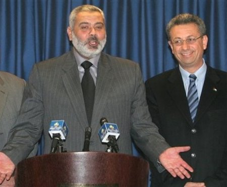 Mustafa Barghouti (r) smiles as irrepressable Hamas leader Ismail Haniyeh tells a joke at a press conference in Gaza, March 2007.