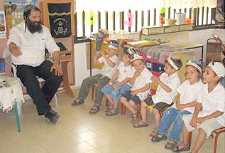 "Rabbi Meir Avshalom Chai, z""l, teaches his kindergarten class at Shavei Shomron. Rabbi Chai was murdered by Palestinian terrorists on Thursday."