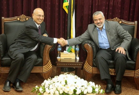 Nabil Shaath (left) shakes hands with Hamas leader Ismail Haniyya after Hamas/Fatah agreement this May.