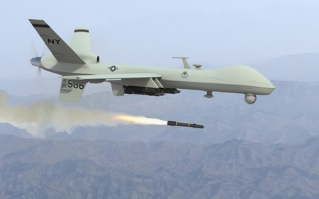 An unmanned Predator launches a Hellfire missile