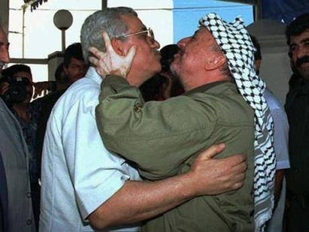 Mahmoud Abbas gets a kiss from his mentor, Original Terrorist Yasser Arafat