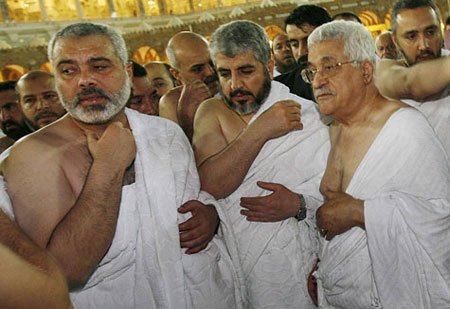 No, it's not a toga party. It's (l-r) Hamasniks Ismail Haniyya and Khaled Mashaal with Mahmoud Abbas back in 2007 after one of their periodic 'reconciliations'