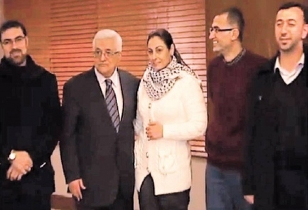 Mahmoud Abbas with recently freed murderer Amna Muna, the 'terrorist temptress'