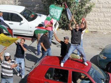 Palestinians demonstrate triumphantly at the second phase of the Gilad Shalit prisoner swap, December 18, 2011