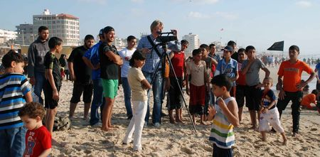 Terje Carlsson films on the Gaza beach