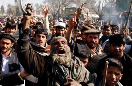 Afghans riot over accidentally burned Qurans