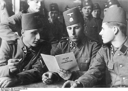 "Bosnian Muslim soldiers of the SS Khanjar Division, raised by Haj Amin al-Husseini, read a pamphlet entitled ""Islam and Judaism"" in 1943"