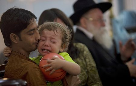 2-year-old Moshe Holtzberg, son of murdered Rabbi Gavriel Holtzberg and wife Rivka, at a memorial service for his parents in Mumbai, India