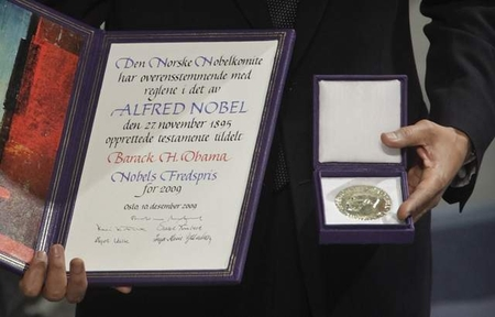 President Obama displays his Nobel Peace Prize