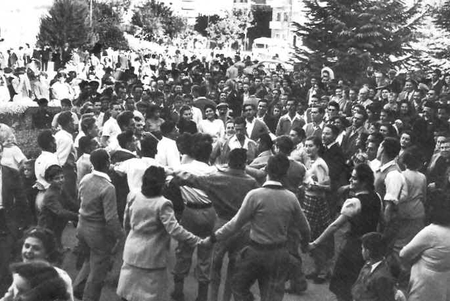 Jews dance in the streets of Tel Aviv, November 30, 1947 (the partition resolution had been approved on the evening of the 29th)