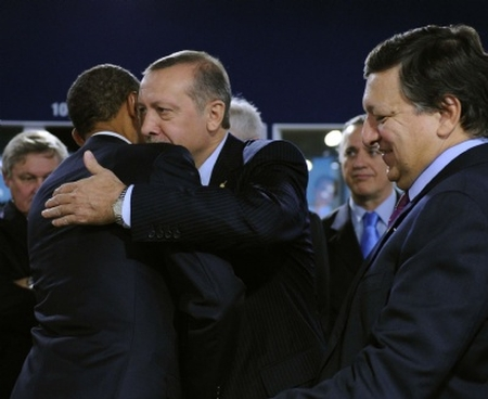 Soulmates: President Obama giving a hug to Turkish Islamist PM Recep Erdoğan at G-20 meeting last November.