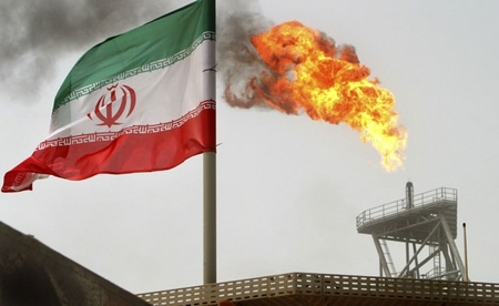 Excess gas flares off at an Iranian oil installation