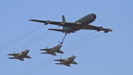 Israeli F15I warplanes practice midair refueling maneuver