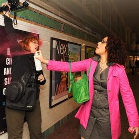 Mona Eltahawy vandalizes subway poster immediately prior to assaulting Pamela Hall and being arrested