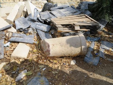 A column, possibly from the Second Temple, lies in a pile of rubble on the Temple Mount