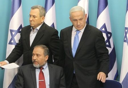 Defense Minister Barak, Foreign Minister Lieberman and PM Netanyahu announce the ceasefire. They aren't smiling.