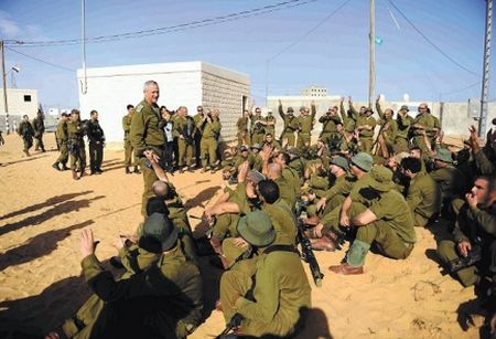 Chief of Staff Benny Gantz talks to troops waiting near Gaza border