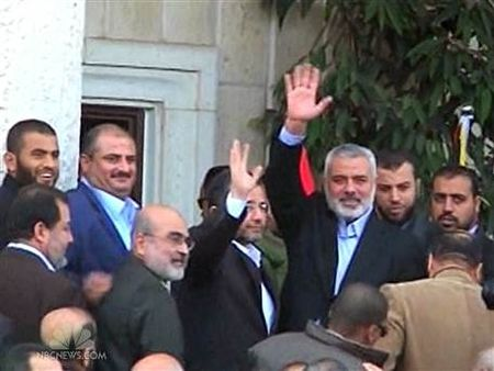 Hamas leader Ismail Haniyeh and other officials smile broadly at the outcome of the conflict