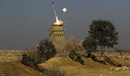 Israel's Iron Dome antimissile system fires an interceptor at Palestinian rocket