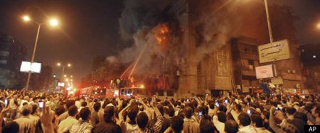 A church burns in Cairo surrounded by angry Muslims, May 2011