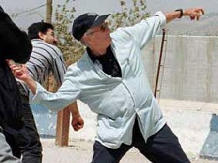 Obama mentor Edward Said symbolically throws a stone at Israel across Lebanese border, July 2000