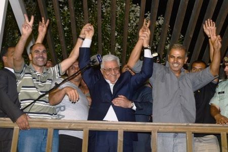 Palestinian 'president' Mahmoud Abbas greets released prisoners in Ramallah, August 14, 2013