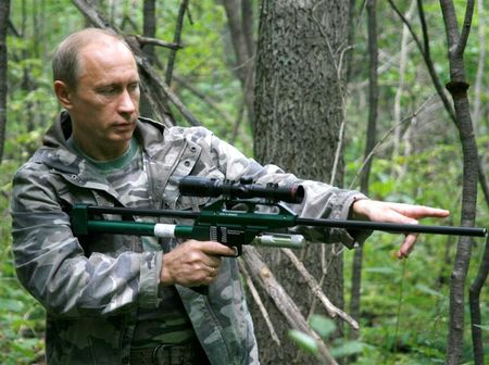 Putin with tranquilizer gun