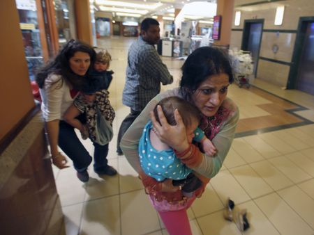 Women with children flee Westgate Mall in Nairobi, Kenya