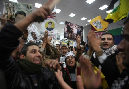 Palestinian Arabs celebrate the return of 26 prisoners from Israel, December 30, 2013. All but 3 were convicted of murder.